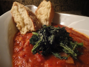 Homemade vegetable & bacon soup with wilted broccoli rabe as well as  homemade garlic & parmesan crusted bread.